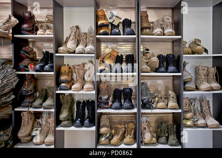 Military combat boot supplies of USA soldiers at the Coffee War cafe Pattaya Thailand. Also an American army supply store - Stock Image