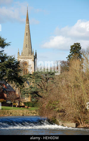 The tower of the Church of the Holy Trinity, Stratford-upon-Avon beside the River Avon - Stock Image