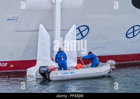 Cleaning A Ships Anchor Tenerife Canary Islands - Stock Image