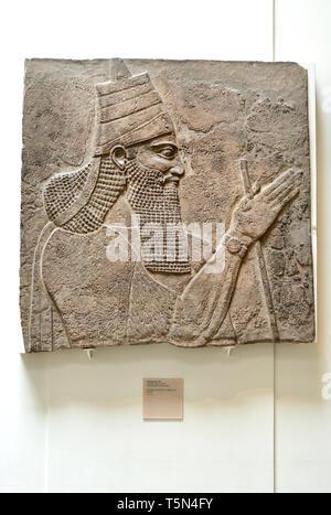 British Museum, Bloomsbury, London, England, UK. Assyrian King Tiglath-pileser III (c728BC) from Nimrud Central Palace - Stock Image