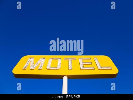 Yellow Neon Motel Sign - Stock Image