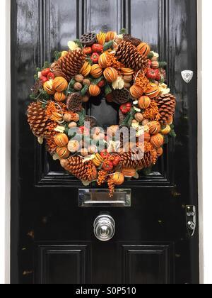Christmas wreath on a door in Chelsea, England. - Stock Image