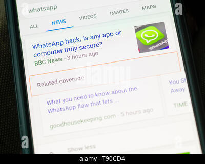 WhatsApp Messenger on a Smartphone, WhatsApp allows users to encrypt their calls and messages for privacy. It is owned by Facebook and founded in 2009 - Stock Image