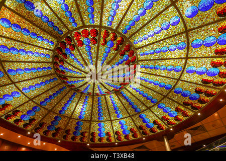 An ornate ceiling and lighting in a cruise ship - Stock Image