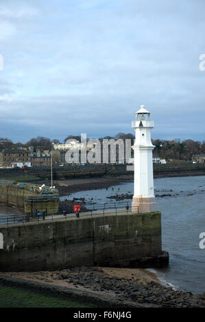 Low tide below the picturesque lighthouse at Newhaven on the outskirts of Edinburgh - Stock Image