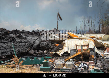 A home in the Leilani Estates crushed by a lava flow from the eruption of the Kilauea volcano May 19, 2018 in Pahoa, Hawaii. - Stock Image