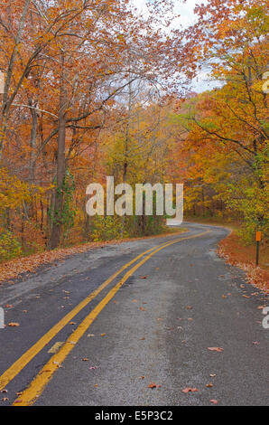 Scenic two lane road with curves in the fall, Autumn - Stock Image