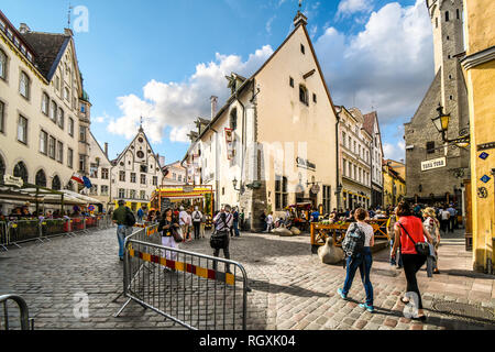 Tallinn, Estonia - September 9 2018: Tourists sightsee and enjoy the shops and sidewalk cafes in the historic Old Town of the medieval city of Tallinn - Stock Image