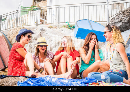 Group of cheerful and happy young women friends enjoy the day during summer vacation together in friendship - people have fun and laugh - beautiful la - Stock Image