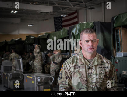 Chief Warrant Officer 2 Gabriel Zettel, Food Program Manager for the New Jersey Army National Guard, stands for a portrait at The National Guard Training Center, Sea Girt, N.J., Aug. 24, 2018. (U.S. Air National Guard photo by Master Sgt. Matt Hecht) - Stock Image