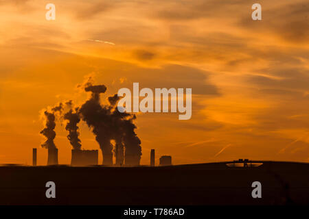 Brown coal power plant of the company RWE Power in Niederaussem at dawn - Stock Image