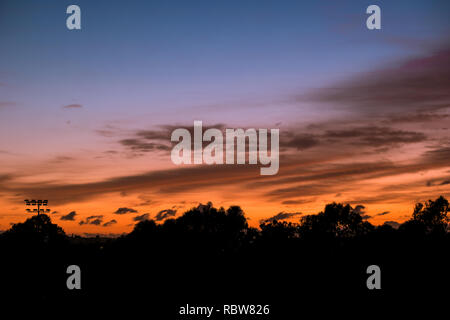 sun rise clouds and trees - Stock Image