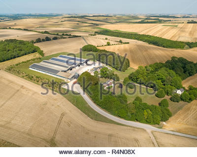 Aerial landscape of farm buildings and harvested summer wheat and barley fields - Stock Image
