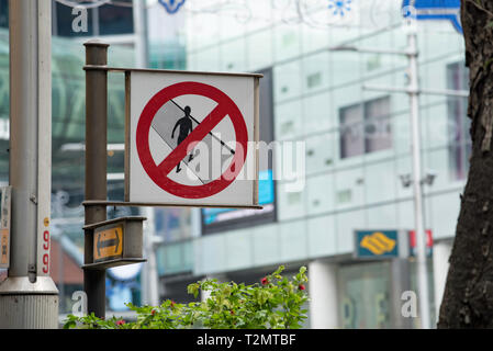 A no Jay Walking sign on Orchard Road in central Singapore - Stock Image