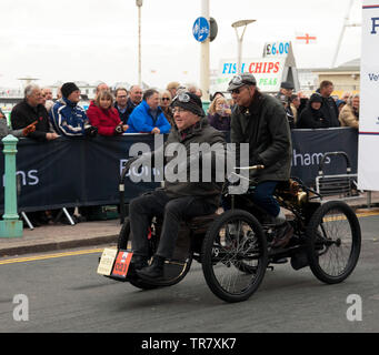 Mr David Oakley driving his 1899 Brown, Quadricycle down Madera Drive, after completing the 2018 London to Brighton Veteran Car Run - Stock Image