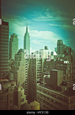 Skyscrapers In City Against Cloudy Sky - Stock Image