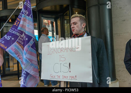 London, UK. 19th October 2018.  A protester holds a placard 'Ignorance is CIS!' s outside the Daily Mail building following articles demonising trans people, particularly trans women, in The Metro which they publish, and their printing an advertisement campaign for the hate group, 'Fair Play for Women'.  Thousands have complained about T Credit: Peter Marshall/Alamy Live News - Stock Image