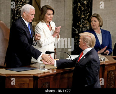 Washington, District of Columbia, USA. 5th Feb, 2019. United States President Donald J. Trump shakes hands with US Vice President Mike Pence after delivering his second annual State of the Union Address to a joint session of the US Congress in the US Capitol in Washington, DC on Tuesday, February 5, 2019. At center is Speaker of the US House of Representatives Nancy Pelosi (Democrat of California) Credit: Alex Edelman/CNP/ZUMA Wire/Alamy Live News - Stock Image