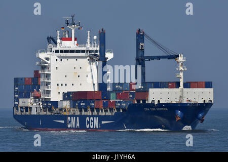 CMA CGM Homere passing Cuxhaven bound for Hamburg - Stock Image