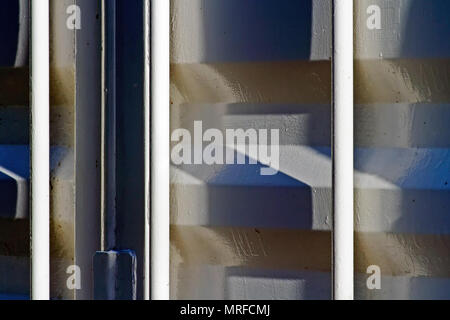The heavy duty steel plates and bars of an industrial storage container form interesting patterns in oblique lighting. - Stock Image