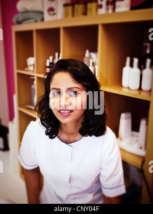 Punjabi woman in her beauty salon. - Stock Image