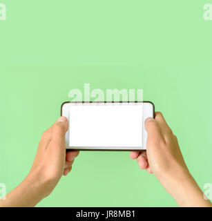 Template of a woman holding a smart device tablet or phone with clipping path for overlays - Stock Image