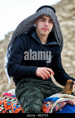 Young man with keffiyeh - Stock Image