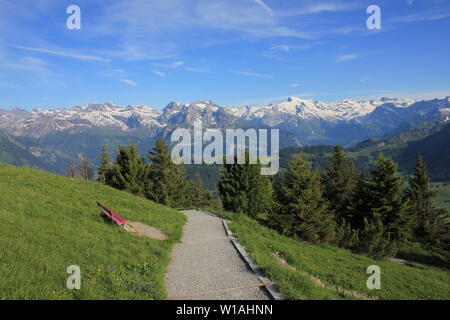 Mount Titlis and other high mountains seen from Mount Stanserhorn, Switzerland. - Stock Image