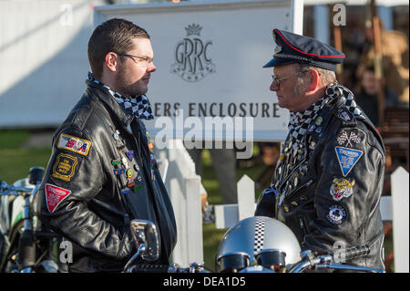 Chichester, West Sussex, UK. 14th Sep, 2013. Goodwood Revival. Goodwood Racing Circuit, West Sussex - Saturday 14th September. Two bikers dressed in black  leather jackets covered in badges talk outside the GRRC members enclosure. Credit:  MeonStock/Alamy Live News - Stock Image