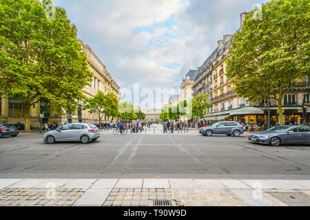 A street scene on the Ile de la Cite in the fourth arrondisement with the Palais du Justice visible on the right side of the pedestrian walkway - Stock Image