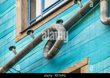 Dresden, Saxony, Germany, December 15., 2018: Rear facade of an artistic building in the Kunsthof-Passage in Dresden-Neustadt with blue paint and biza - Stock Image