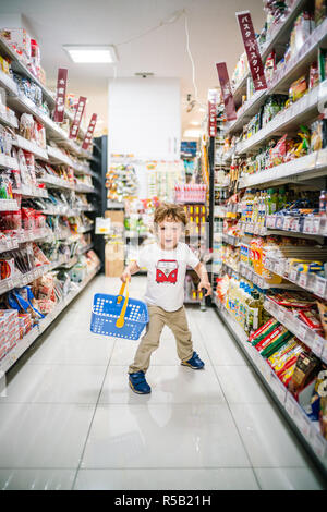Child in a supermarket. - Stock Image