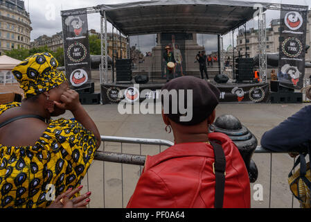 London, UK. 18th August 2018. The annual National Memorial event in Trafalgar Square remembers and honours the victims of the African Holocaust/Transatlantic Slave Trade and promoted International Slavery Remembrance Day, 23rd August. The event called for Africans to celebrate their identity and to remember their ancestors, and began with libations remembering many black heroes. ers talked about the discrimination in the UK education system and the e Credit: Peter Marshall/Alamy Live News - Stock Image