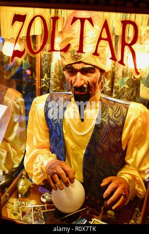 Close-up of animatronic fortune-telling machine, after receiving payment, makes a prediction 'Zoltar Speaks' from Zoltar, by Characters Unlimited. - Stock Image