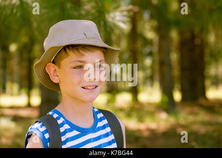 Boy hiking in woods, portrait - Stock Image