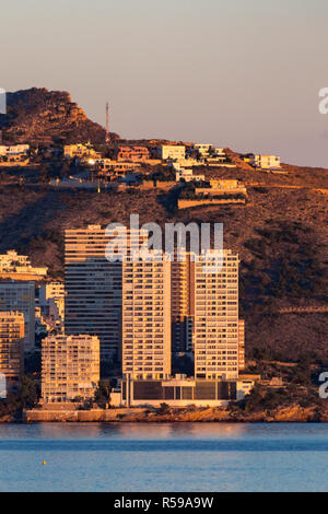 The two white towers known as Gemlos 28 in the Punta Lisera district of Benidorm overlooking Levante Beach will soon have to be demolished, with a plan required to be formulated within 3 months. The operation will cost the Generalitat Valenciana in excess of 100 million euros including compensation to the people who bought apartments in good faith before the project was declared illegal in 2012. The twin towers are 28 floors high, with 168 luxury apartments and they stand a few metres from the sea adjoining the Serra Gelada natural park. More info in the description. - Stock Image