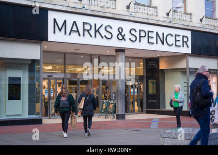 The Marks & Spencer store in Broad Street, Reading, Berkshire with passers by. - Stock Image