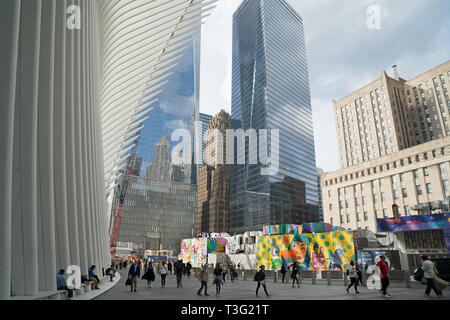 A plaza at the World Trade Center site in Lower Manhattan's Financial District borders the Oculus, new skyscrapers, and landmarked Art Deco buildings. - Stock Image