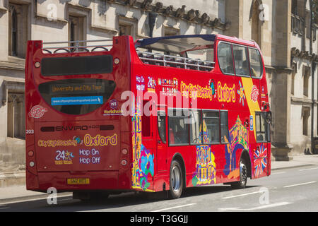An open top, double-decker tour bus in the High Street, Oxford - Stock Image