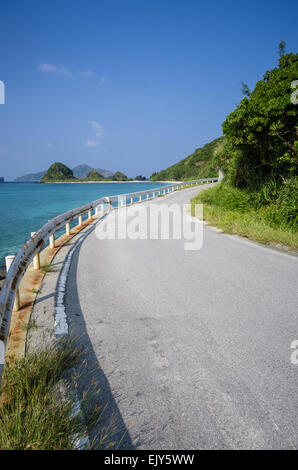 Road running next to the ocean on Zamami Island, Okinawa, Japan - Stock Image