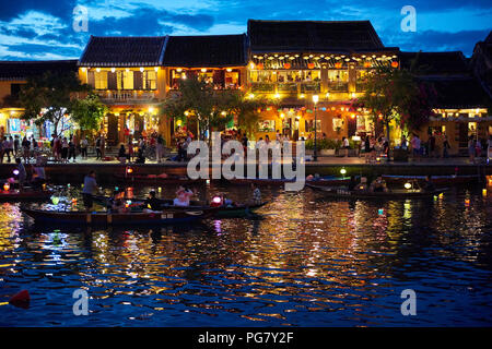 The previously tranquil town of Hoi An, in Vietnam, is nowadays taken over by rampant tourism. The local tradition of lighting a paper lantern and mak - Stock Image