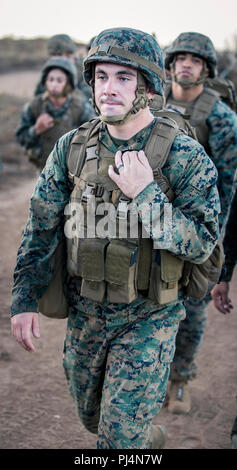 Marine Corps Base Camp Pendleton, CA -- Staff Sgt. Andrew Thomas, comptroller chief with the 11th Marine Expeditionary Unit, participates in a six mile conditioning hike aboard Camp Pendleton, Calif., Aug. 30, 2018. The purpose of the training was to maintain unit readiness by increasing physical fitness and morale. (United States Marine Corps photo by Lance Cpl. Jason Monty) - Stock Image