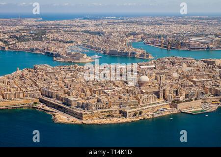 Malta aerial view. Valetta, capital city of Malta, Grand Harbour, Senglea and Il-Birgu or Vittoriosa towns, Fort Ricasoli and Fort Saint Elmo from abo - Stock Image
