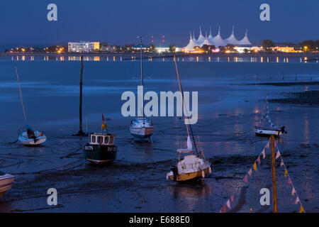 Night time view of Minehead, seen across bay from the harbour. The distinctive white roof of Butlins holiday camp - Stock Image