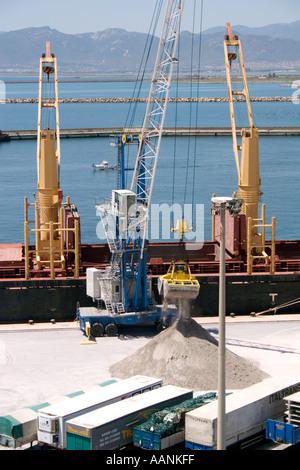 truck lorry wait waiting at Cagliari Port Sardinia truck lorry harbour harbor dock dockside crane boat ship cargo salt load load - Stock Image