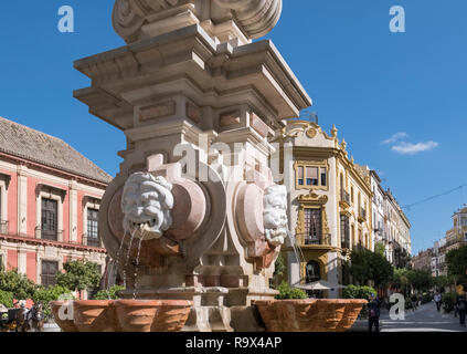 Drinking fountain in popular tourist spot, Plaza Virgen de los Reyes, Seville, Spain - Stock Image