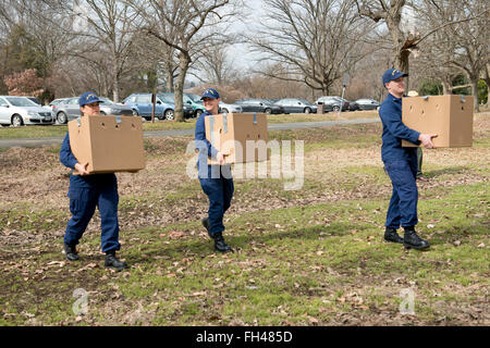 Lt. j.g. Karinne Merical, Petty Officer 3rd Class Laurel Siegrist and Petty Officer 3rd Class Christopher Worth, - Stock Image