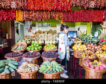 Madeira, Portugal - October 31, 2018: Stand in Mercado dos Lavradores, a local market in Funchal, the capital of Madeira island, Portugal. - Stock Image