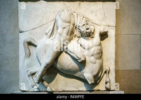 Part of the Elgin Marbles in the British Museum, London, UK. Lapith and Centaur fighting, South Metope II - Stock Image