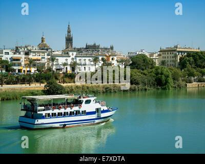 A riverboat on the Rio Guadalquivir in Seville - Stock Image